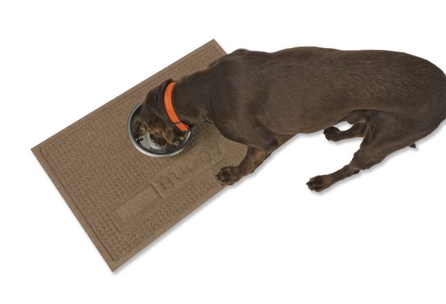 Protect your floors from water damage and keep the area under your pet's feeding station clean with our thirsty indoor/outdoor Water Trapper dog placemat. Able to absorb up to a gallon of liquid per square foot, these superstrong commercial-grade polypropylene placemats trap water, crumbs, and dirt and are backed with sturdy rubber for traction so dog bowls and feeders will stay put. And because big dogs make big messes, we also offer a larger size with 65% more surface area. Easy ...