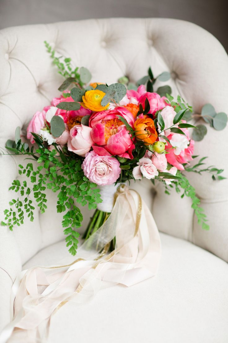 Bright pink peony and eucalyptus wedding bouquet: Photography : Asya Photography Read More on SMP: http://www.stylemepretty.com/pennsylvania-weddings/2017/02/21/a-little-pop-of-peony-takes-this-barn-to-another-level-of-beauty/