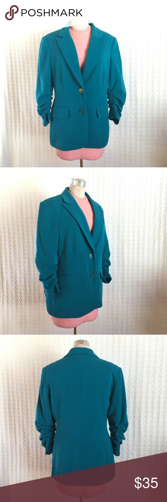 Michael by Michael Kors Turquoise Blazer Gently used turquoise blazer from Michael by Michael Kors; this is a great blazer with ruched sleeves, great tailoring, and double button closure. Does show some piling at the armpits, otherwise in good condition.   Laying Flat Measurements are:  Chest- 19 in Waist- 17.5  in Hips- 19.5  in Overall Length- 27 in MICHAEL Michael Kors Jackets & Coats Blazers