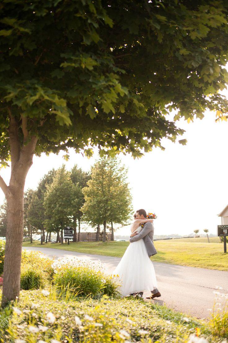 Rockway Vineyards Wedding, Niagara - Bride and groom sharing a loving embrace. #sweetheartempirephotography