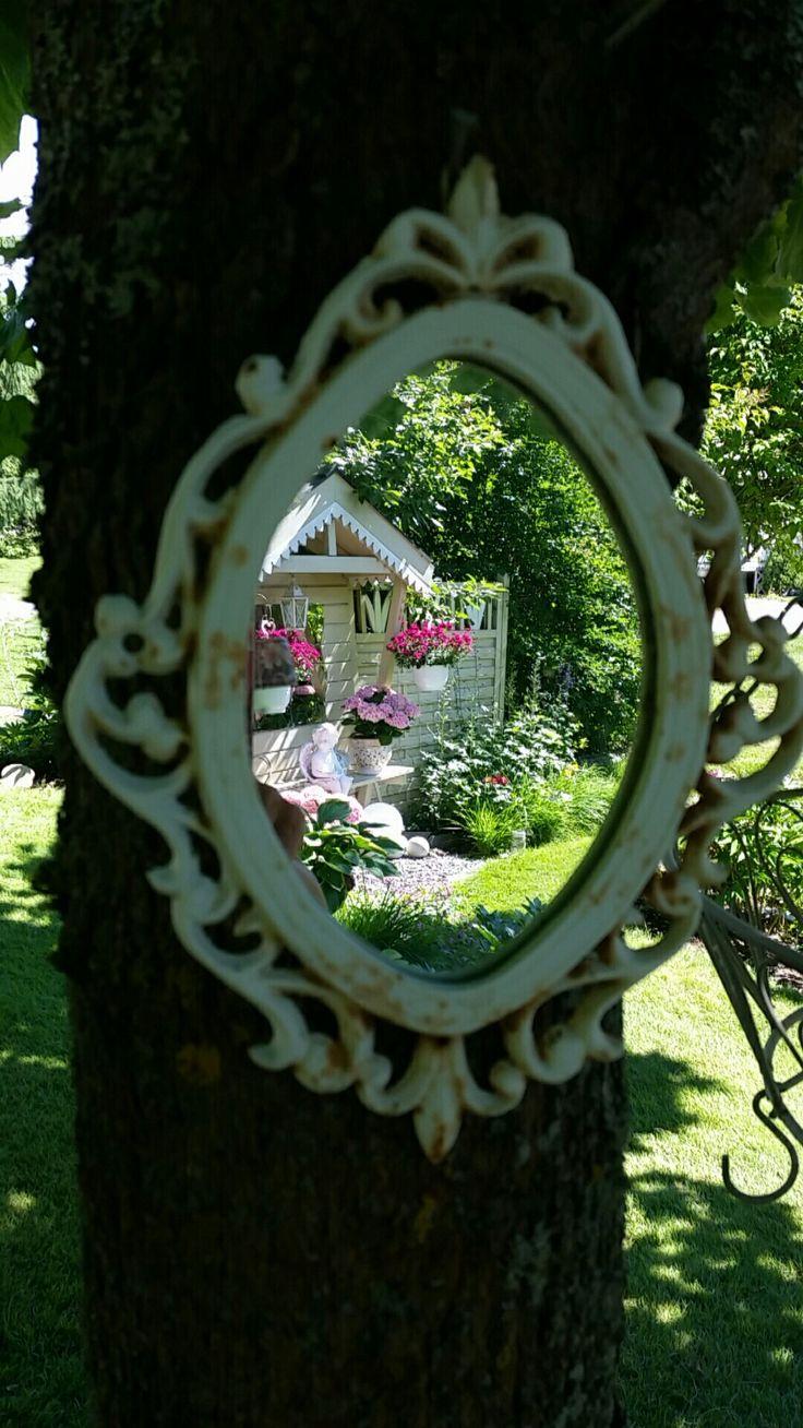 Speil i hagen.