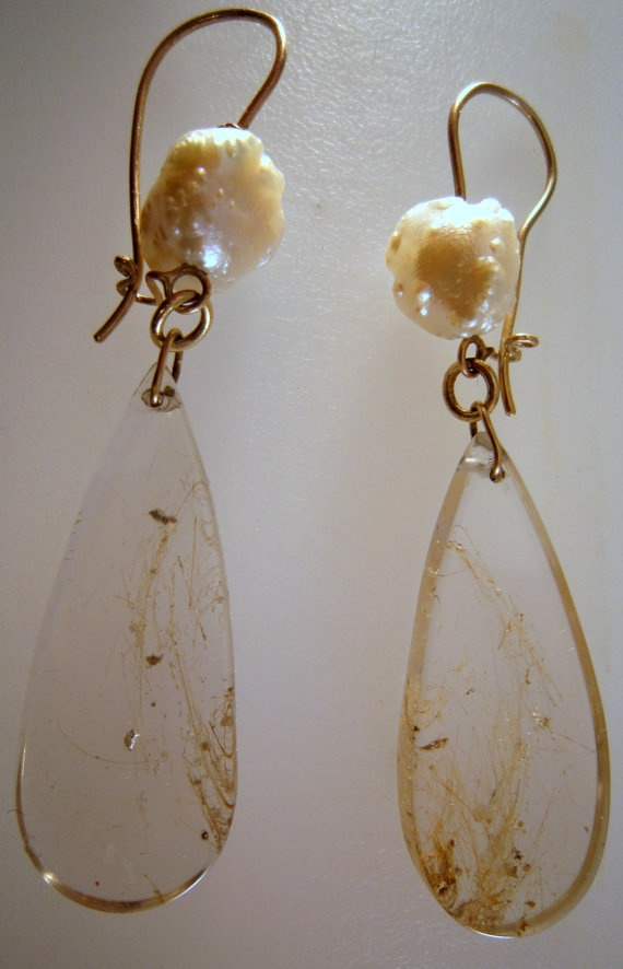 Light, transparent in white creamy colours dangly earrings so much in vogue for summery trends by Kochi Okada