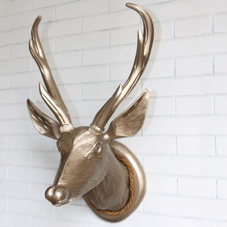Hiasi ruangan anda Wooden Deer Head dengan balutan warna emas. Dengan bahan kayu jati dan dari desainer indonesia, hanya di 2madison kualitas terbaik home furniture indoensia.