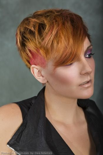 An edgy and bold short cut and color.   By Dee Adames