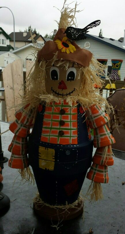 My try on a scarecrow clay pot creation