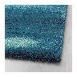 Le velours dense et épais atténue le bruit et constitue une surface douce sous les pieds. Ce tapis en fibres synthétiques est résistant, anti-tache et facile d'entretien.