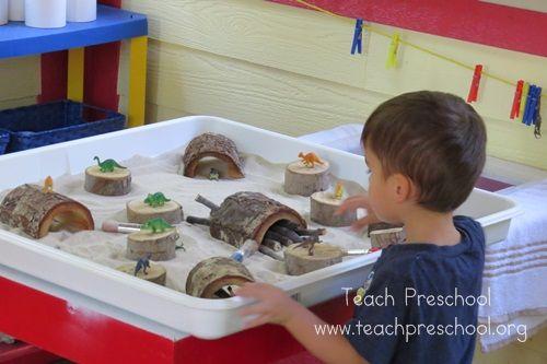 Dinosaur land in the sand table - Teach Preschool