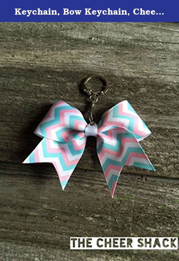 """Keychain, Bow Keychain, Cheer Bow Keychain, Chevron Bow Keychain. Pink, White, and Blue Chevron cheer bow keychain. 1.5"""" grosgrain ribbon. Embellished with The Cheer Shack's signature rhinestone. Great for decorating backpacks, bags, etc. Print design and color on each bow may vary."""