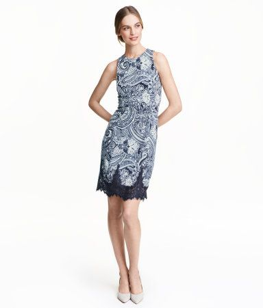 Knee-length, sleeveless, fitted dress in textured jersey with a printed pattern. Visible metal zip at back and wide lace trim at hem. Unlined.