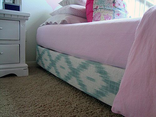 like this idea for covering box spring: lifted box-spring with wooden legs and wrap the box-spring in Laura Ashley's gorgeous teal ikat print.  I glued the fabric to the box-spring using Fabri-Tac.... a super, simple project and well worth the time.  No more adjusting a bed-skirt every time I make the bed!