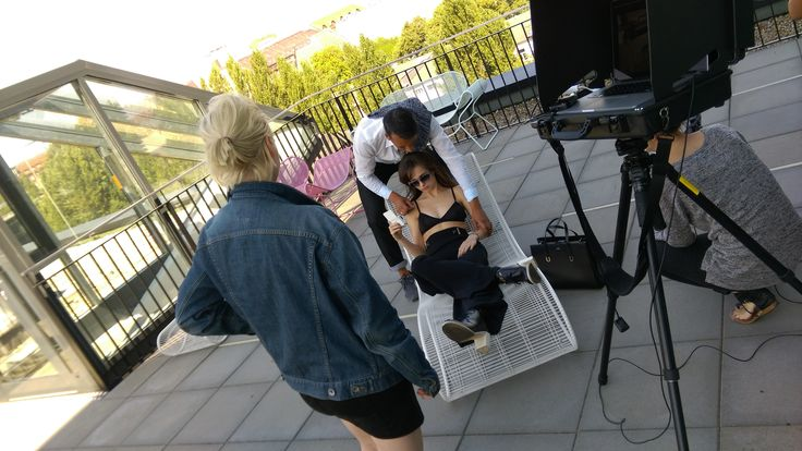 #Model getting ready for the shot with the #fashion #stylist on the balcony of the #nhotel in #berlin