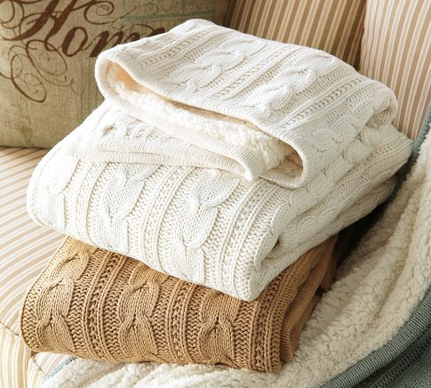 Cable knit throw with faux-sheepskin reverse from Pottery Barn.