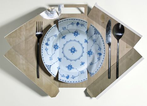 A sandwich box that folds out into a classy looking plate. Comes in a number of different designs.