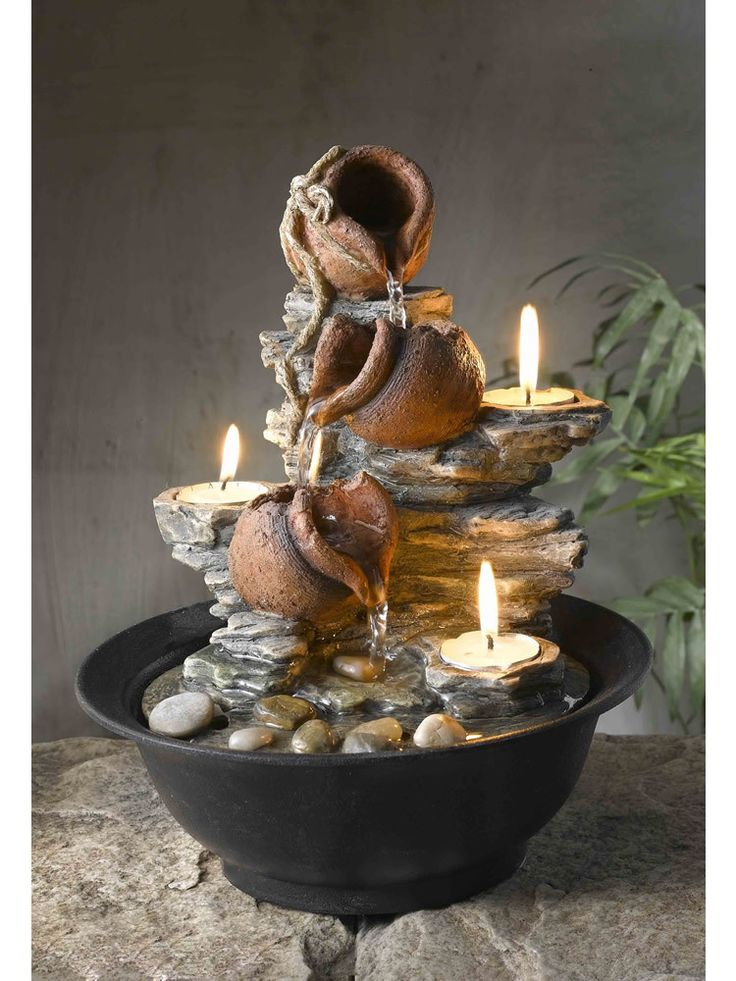 The Candle and Pot Tabletop Fountain features tiers of flowing water and tealight candles. Three delicate tea lights help add light to the Candle and Pot Tabletop Fountain - Measures 9 inches Wide x 9
