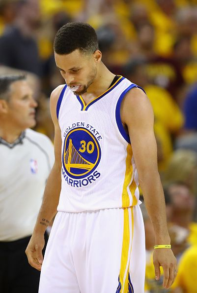 Stephen Curry of the Golden State Warriors reacts during the second half against the Cleveland Cavaliers in Game 7 of the 2016 NBA Finals at ORACLE...