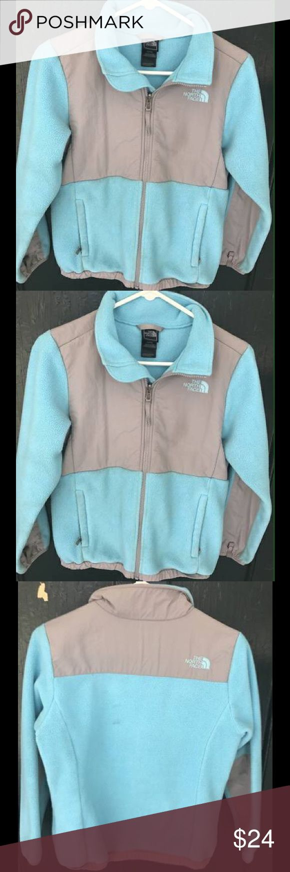 Girls North Face Fleece Jacket It  is a size large 14/16 girls, color is aqua and grey, a little worn but looks in great condition, has a slight stain on the back. North Face Jackets & Coats
