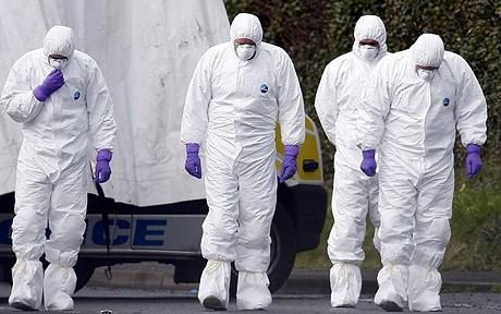 writing prompt: men in white forensic suits were going in and out of the building…