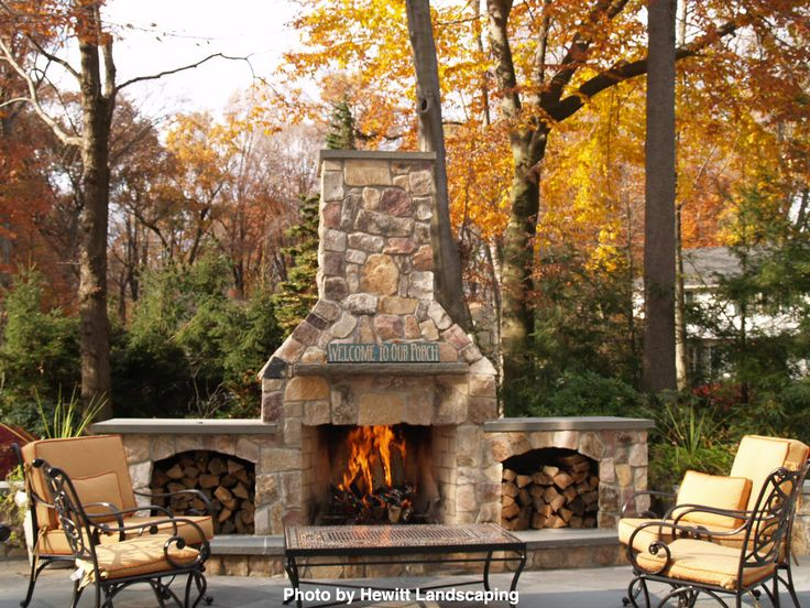 large brick outdoor fireplace with two covered sections to