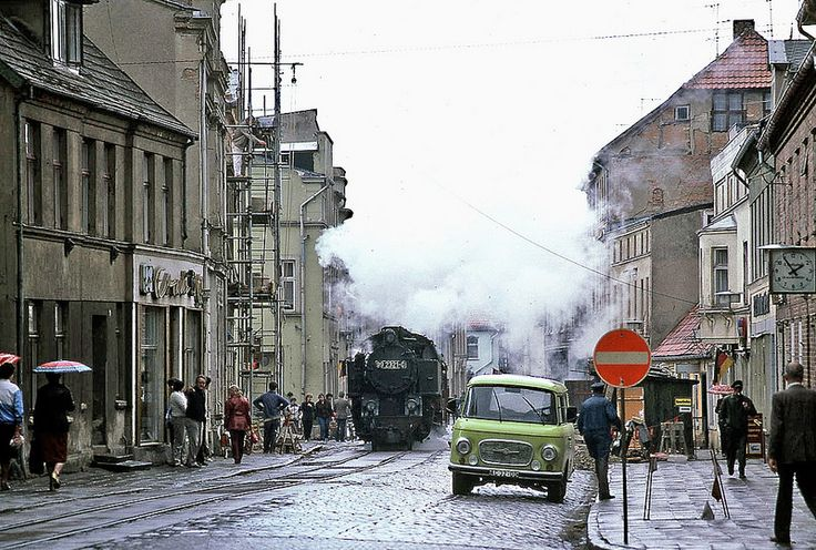 Bad Doberan, East Germany. The lime colored van in the foreground is a BARKAS.