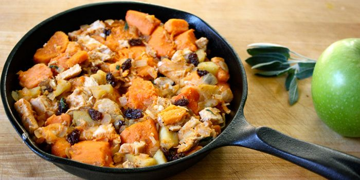 Hearty Chicken Sweet Potatoes Apples in a cast-iron skillet 3 tsp. olive oil, divided use 1 medium onion, chopped 2 medium tart cooking apples (like Granny Smith or pippin), peeled, cored, finely chopped 2 cups cubed baked sweet potato, cut into cubes ¼ cup raisins 8 oz cooked chicken breast, boneless, skinless, chopped 1 tsp. chopped fresh sage ¼ tsp. sea salt ¼ tsp. ground black pepper ¼ tsp. paprika