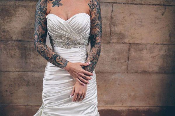 Many brides love the look of a shrug with a strapless sweetheart neckline. This bride had the look without buying one! Like her, if you are heavily tattooed, find a dress that will create flattering shapes with the existing ink.