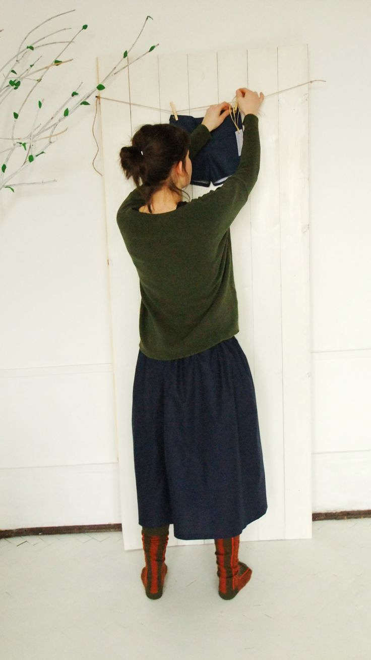 Navy skirt and green oversize blouse.