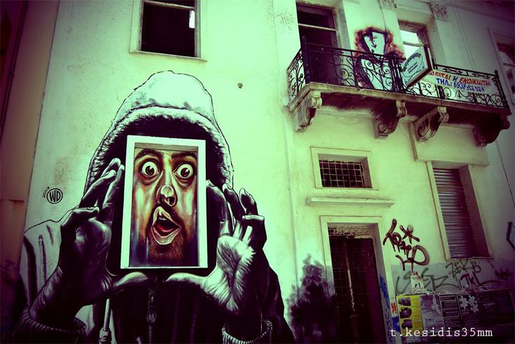 Graffiti in Athens by Tolis Kesidhs