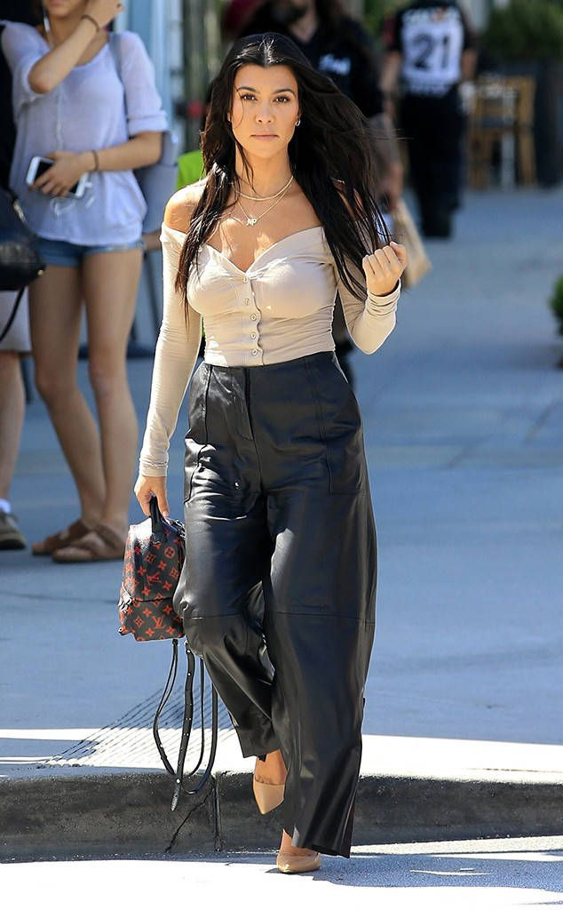 Kourtney Kardashian from The Big Picture: Today's Hot Photos  Brunette beauty! The reality star is seen wearing black leather pants and an off the shoulder top while out and about in Los Angeles.