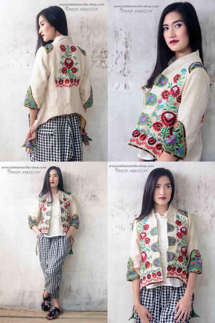 Batik Amarillis Made in Indonesia proudly presents :Batik Amarillis's Arcana jacket in Hungarian embroidery on natural, raw and beautiful Tenun gedog Tuban of Indonesia with tenun batik gedog Piping .