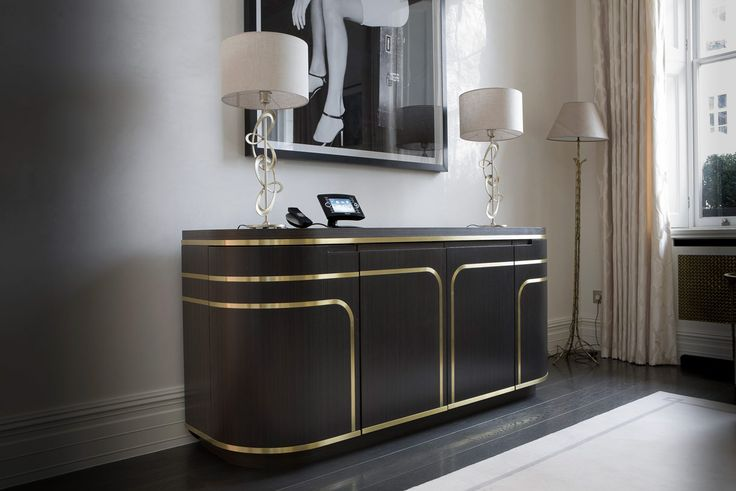 INTERIOR-iD project with Candy & Candy: #bespokejoinery Curved bar unit with flush fitted 3D-curved brass inlays. Library with concealed LED lights and antique mirror panels in sunburst pattern.