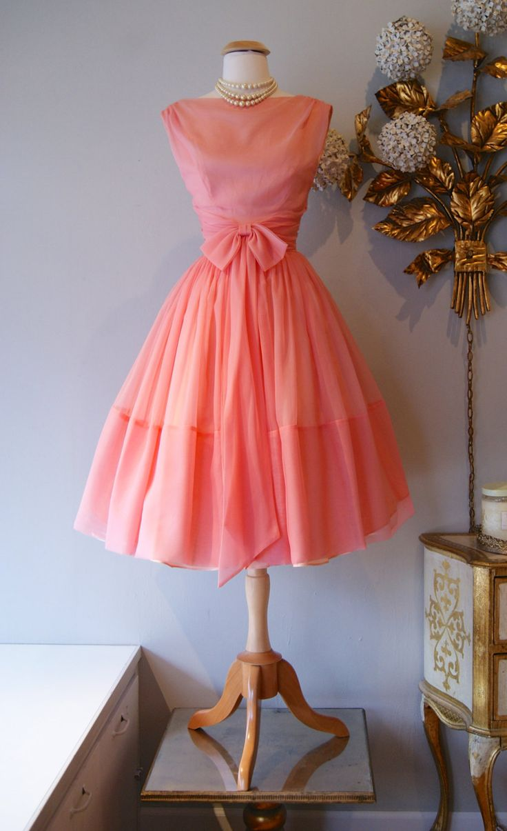1960s Dress // Vintage 60s Dress // Vintage Peachy Pink Party Dress With Bow Size S. $248.00, via Etsy.