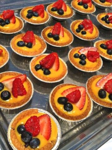 Mini lilikoi tarts topped with strawberries and blueberries- Maui Catering Services
