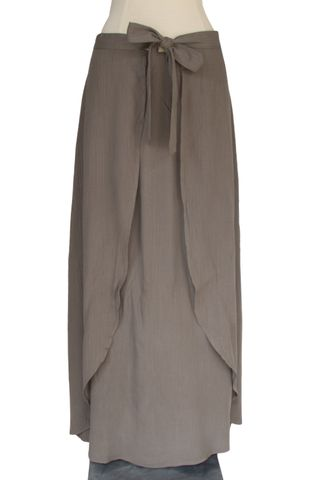 We are yet to meet a maxi skirt we didn't like; however, this beauty might just take the cake as our all time favorite skirt in that category. A smooth olive hue makes up the body of the piece, allowi