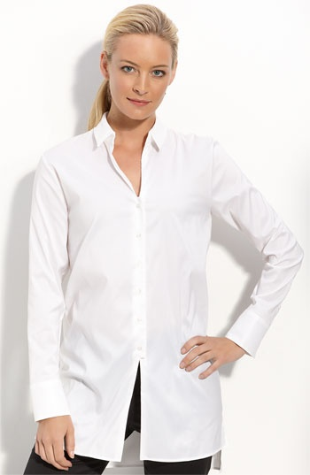Crisp tunic-length shirt is styled with an open V-neck and a longer back hem for a relaxed fit. Slits at the front and sides further ease the style