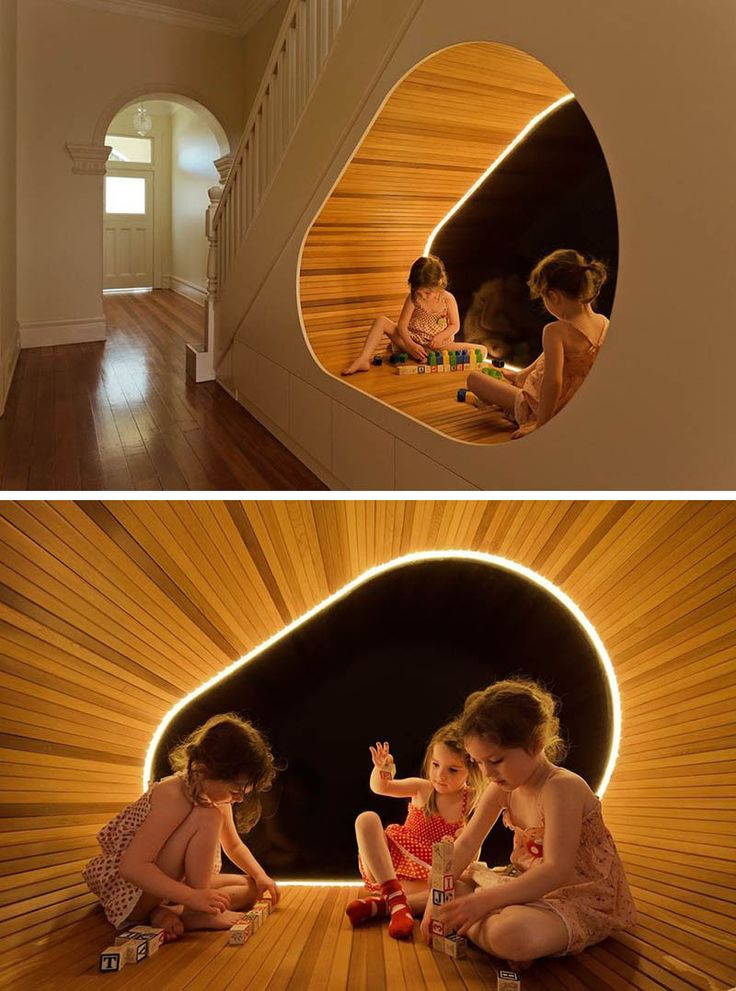11 Kids Only Hideouts That Even The Biggest Grownups Would Be Jealous Of // The extra space under the stairs in this family home has been converted into a play area complete with tube lighting and a wood finish.