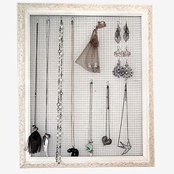 Thrifted picture frame to create your own jewelry holder.