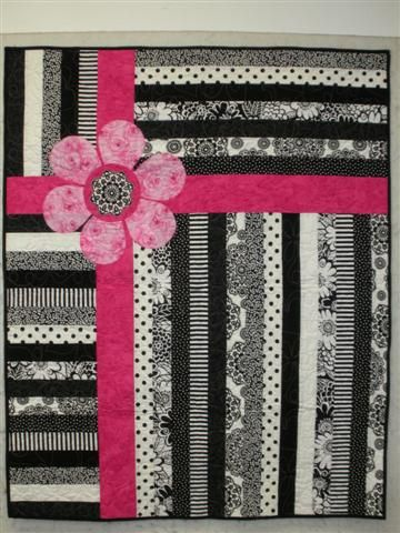 Great idea for a quilt, replace the flower with a race car (or another shape)…