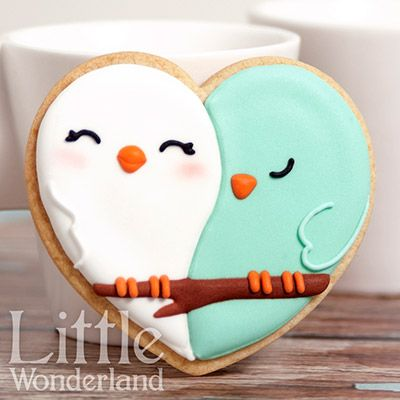 What adorable, perfect Valentine's day cookies!  Sweet little love birds made with a heart cutter.