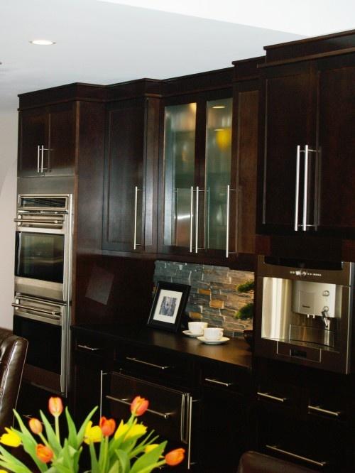 Dark kitchen cabinets and silver appliances... Love!