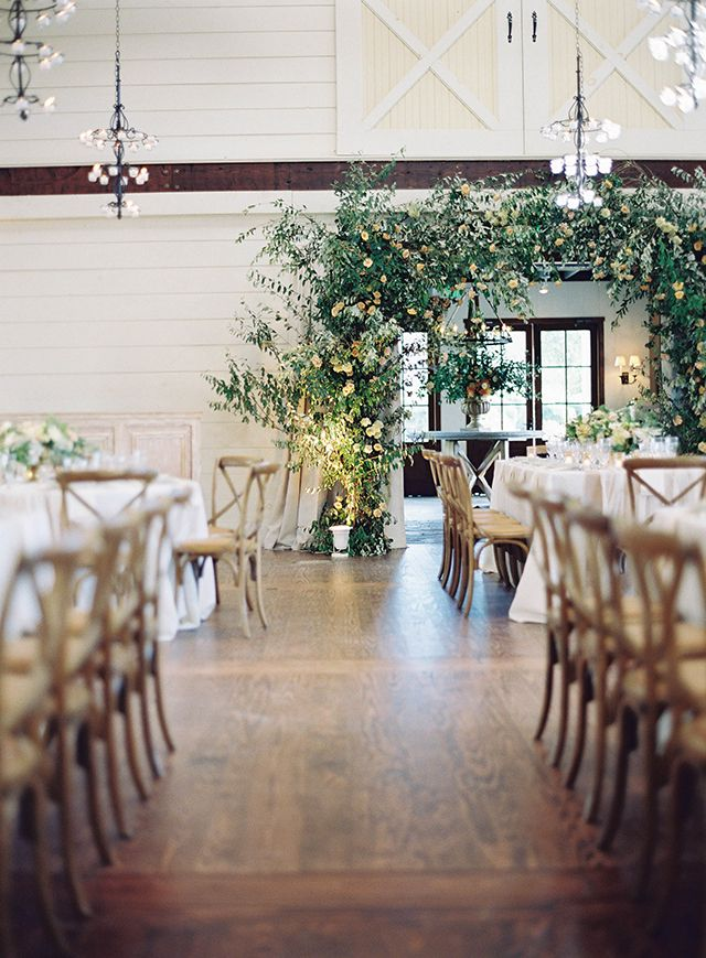 Wild floral arch over doorway at Pippin Hill Farm created by Ariella Chezar.  Planning & Design: Easton Events, photo: Tec Petaja