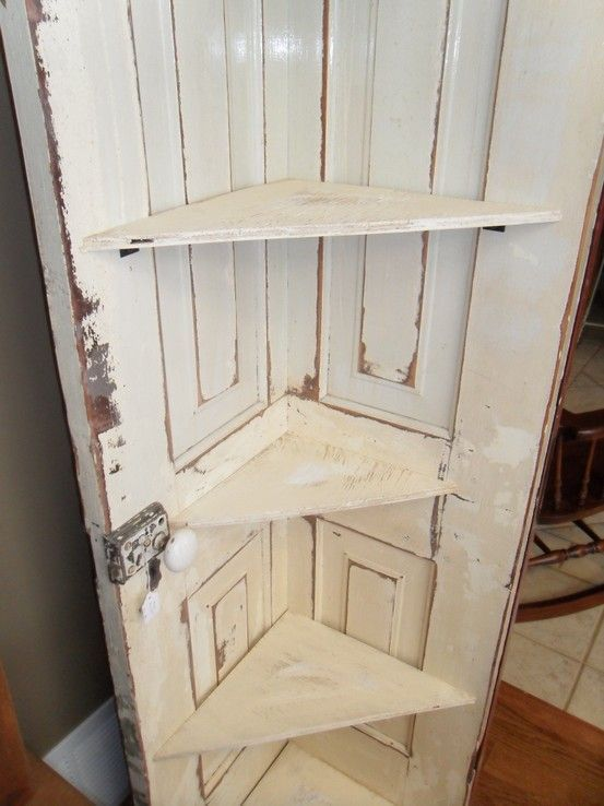 Old door cut in half and turned into a corner shelf