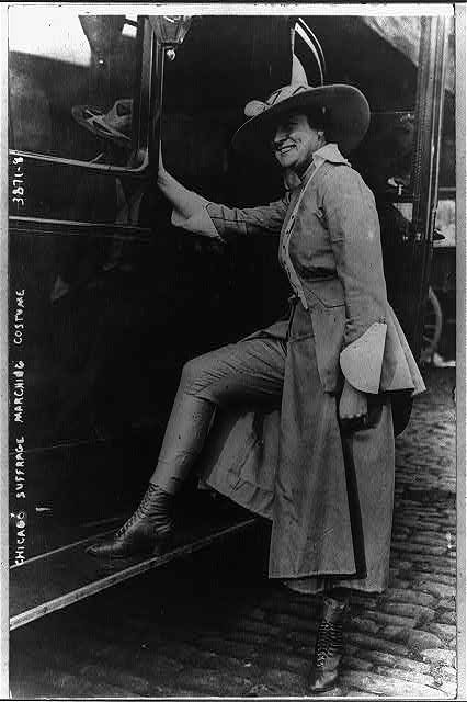 Woman modelling marching costume for Chicago's suffrage parade, June 6, 1916