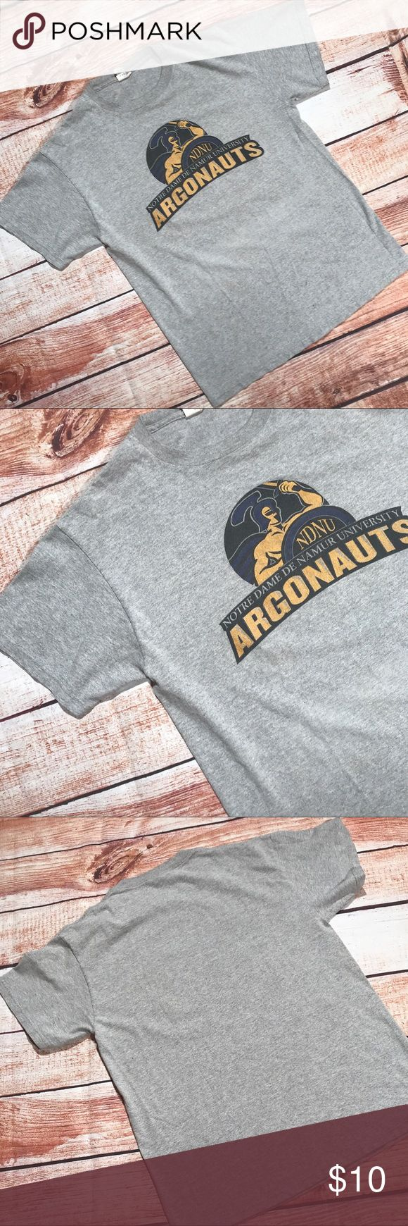 ▪️v i n t a g e : notre dame argonauts t-shirt v i n t a g e : Gray notre dame university  argonauts team mascot t-shirt. Good condition, is faded from wash, no other flaws. Zero clue what sport this would be because I was always under the impression notre dame was the fighting irish.. lol. Either way it's a size medium (no tag) unisex.   ——- #bogo #freeship #sale #clearance #gift #present #Vintage #vtg #retro #college #university #notredame #argonauts #team #sports Vintage Tops Tees - Short…