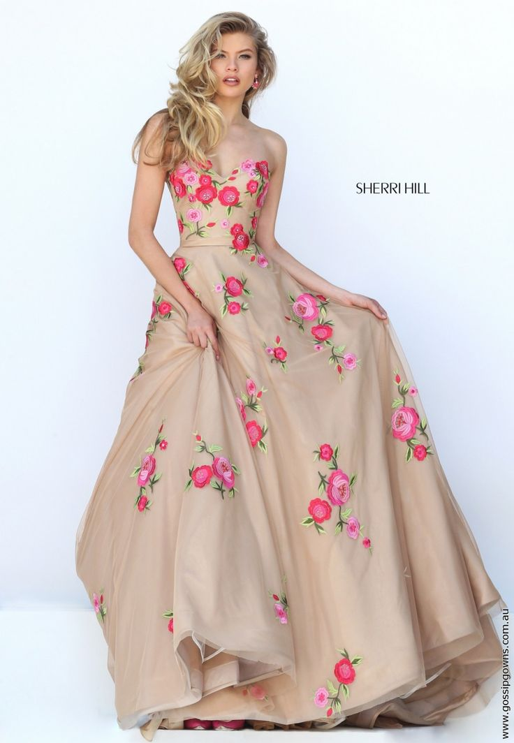 Amazing in so many ways! Love the nude base colour and the little bright pink embroidered flowers. Would look amazing with similarly coloured shoes.