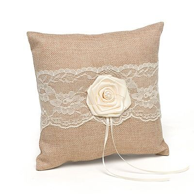 """Rustic Country Ring Pillow Set the tone for your rustic and romantic """"I do"""" with this burlap wedding ring pillow. The ring bearer pillow gets a pretty kick with a lace band and a satin rosette"""