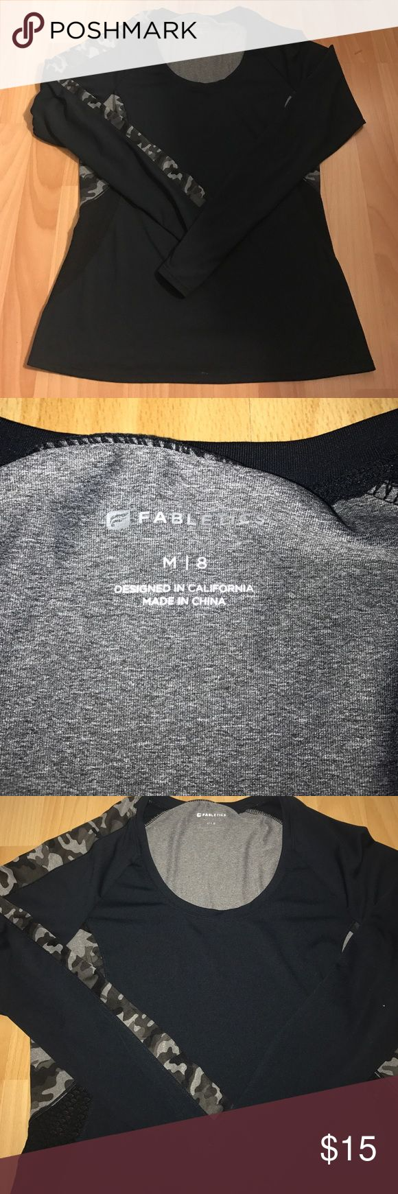 Fabletics top This black and gray camo top has camo detail down one sleeve and camo detail in the back with venting in the lower back area and is made of a wicking material Fabletics Tops Sweatshirts & Hoodies
