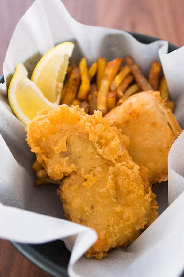 Moist, tender fish fillets wrapped in a light crispy beer batter, servered with crunchy twice fried chips.