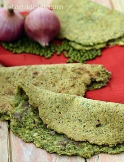 When you are in Andhra Pradesh, you must try their famous whole green moong dosas, known as Pesarattu. On the other hand, you can try it right away in your own kitchen! These delicious green gram dosas include a little bit of rice for crispness, as well as green chillies and ginger for an elegant flavour. They are usually filled with sautéed onions, but some people like to use raw onions and coriander, instead. Yet others like to serve it as Special Pesarattu, stuffed with delicious rava…