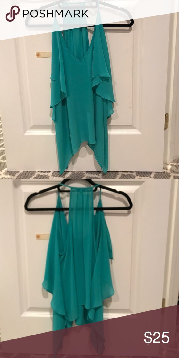 Brand new turquoise shirt Brand new turquoise shirt. Naked Zebra Tops Tank Tops