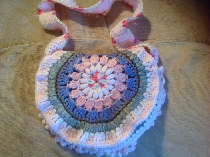 Front view of a Childs ham bag/purse created from three crocheted granny circles and designed by Julie Farmer